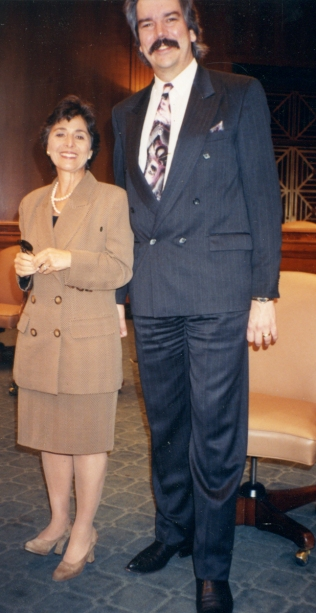 "Barbara Boxer is not a large woman. At 6'5"" tall, I ended up looking like the Jolly Green Giant in this photo with her."